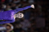 Gold medalist USA's Mc Kayla Maroney celebrates on the podium of the vault event of the Apparatus Final at the 44th Artistic Gymnastics World...