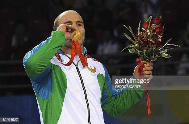 Gold medalist Uzbekistan's Artur Taymazov kisses his medal during the medal ceremony for the mens' wrestling 120Kg at the 2008 Beijing Olympic Games...