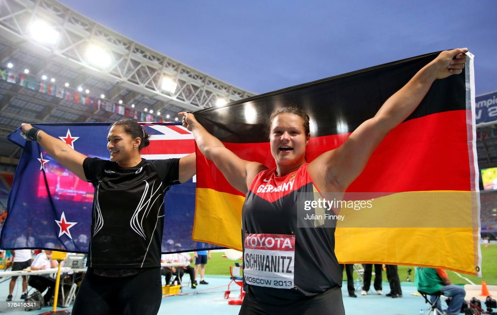 Gold medalist <a gi-track='captionPersonalityLinkClicked' href=/galleries/search?phrase=Valerie+Adams&family=editorial&specificpeople=2174723 ng-click='$event.stopPropagation()'>Valerie Adams</a> of New Zealand and silver medalist <a gi-track='captionPersonalityLinkClicked' href=/galleries/search?phrase=Christina+Schwanitz&family=editorial&specificpeople=2287569 ng-click='$event.stopPropagation()'>Christina Schwanitz</a> of Germany celebrate after the Women's Shot Put Final during Day Three of the 14th IAAF World Athletics Championships Moscow 2013 at Luzhniki Stadium on August 12, 2013 in Moscow, Russia.
