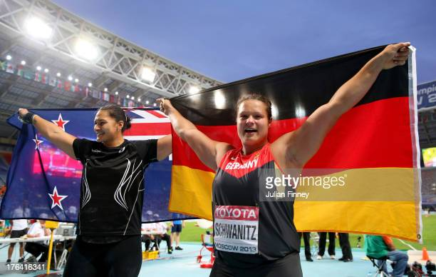 Gold medalist Valerie Adams of New Zealand and silver medalist Christina Schwanitz of Germany celebrate after the Women's Shot Put Final during Day...