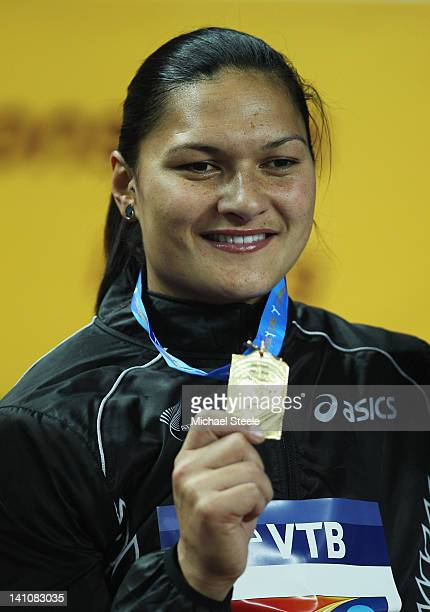 Gold medalist Valerie Adams of New Zealand stands on the podium during the medal ceremony for the Women's Shot Put Final during day two of the 14th...