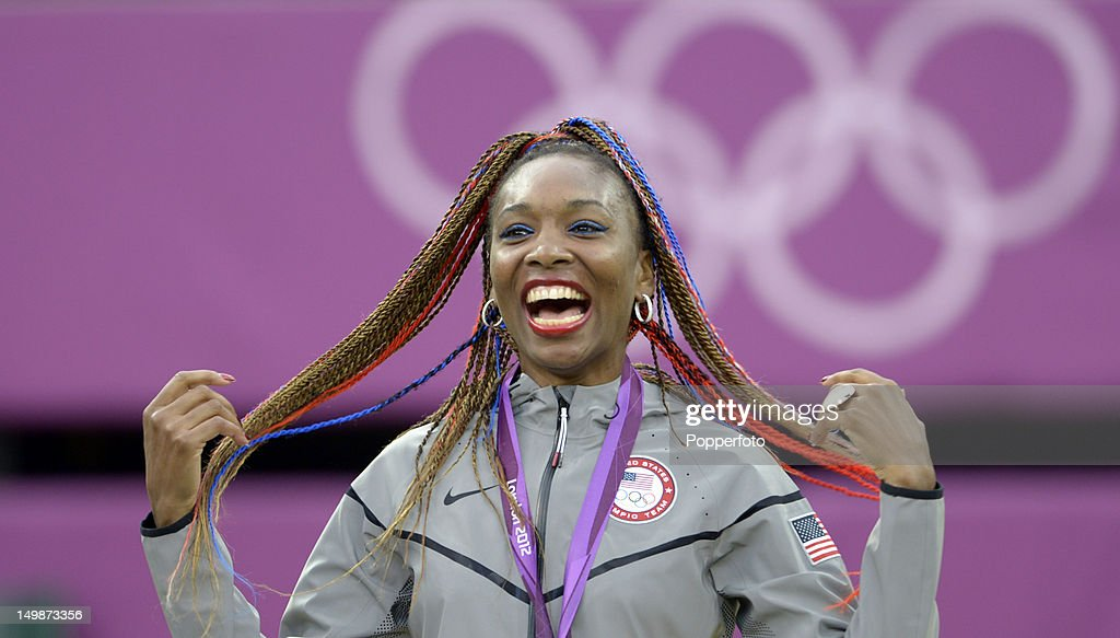 Gold medalist Venus Williams of the United States celebrates during the medal ceremony for the Women's Doubles Tennis on Day 9 of the London 2012 Olympic Games at the All England Lawn Tennis and Croquet Club on August 5, 2012 in London, England.