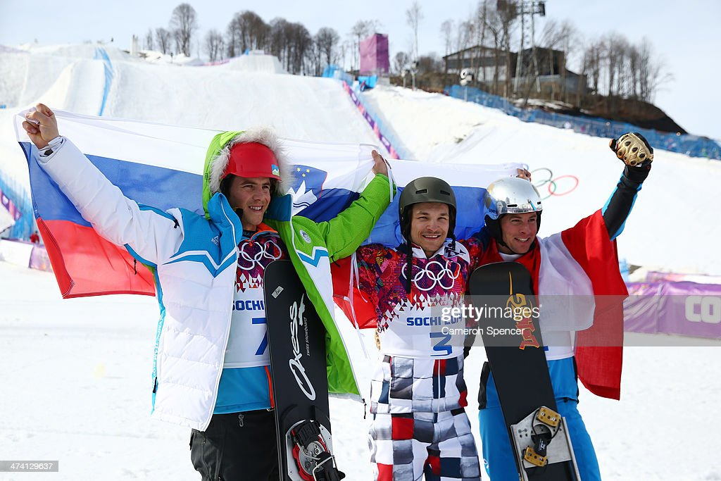 Gold medalist <a gi-track='captionPersonalityLinkClicked' href=/galleries/search?phrase=Vic+Wild&family=editorial&specificpeople=6691731 ng-click='$event.stopPropagation()'>Vic Wild</a> (C) of Russia celebrates with silver medalist Zan Kosir (L) of Slovenia and bronze medalist <a gi-track='captionPersonalityLinkClicked' href=/galleries/search?phrase=Benjamin+Karl&family=editorial&specificpeople=4586461 ng-click='$event.stopPropagation()'>Benjamin Karl</a> of Austria during the flower ceremony in the Snowboard Men's Parallel Slalom Big Final on day 15 of the 2014 Winter Olympics at Rosa Khutor Extreme Park on February 22, 2014 in Sochi, Russia.