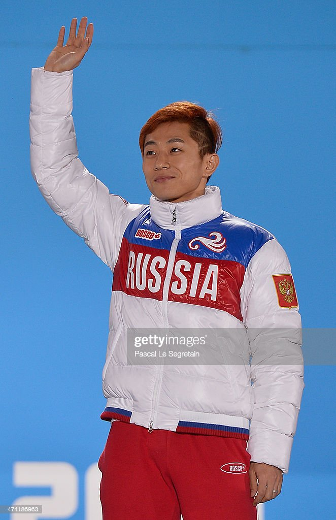 Gold medalist Victor An of Russia celebrates on the podium during the medal ceremony for the Short Track Men's 500m on Day 15 of the Sochi 2014 Winter Olympics at Medals Plaza on February 22, 2014 in Sochi, Russia.