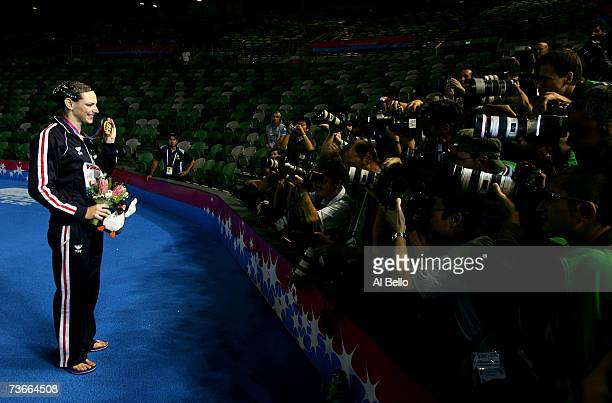Gold medalist Virginie Dedieu of France poses for photographers after receiving her medal in the Solo Free Routine at the synchronized swimming event...