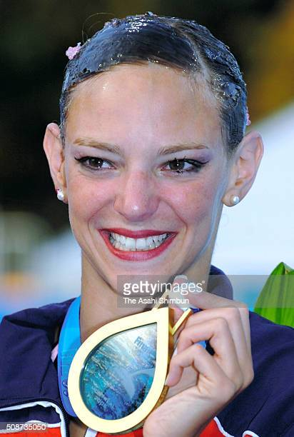 Gold medalist Virginie Dedieu of France poses for photographs at the medal ceremony for the Synchronized Swimming Solo during day six of the FINA...