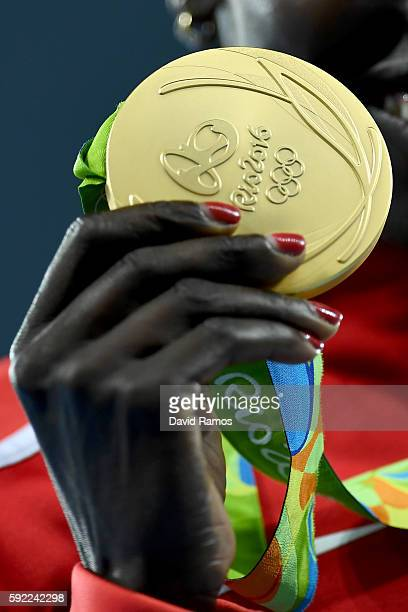 Gold medalist Vivian Jepkemoi Cheruiyot of Kenya poses on the podium during the medal ceremony for the Women's 5000m on Day 14 of the Rio 2016...