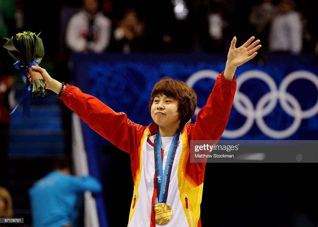 Gold medalist <a gi-track='captionPersonalityLinkClicked' href=/galleries/search?phrase=Wang+Meng&family=editorial&specificpeople=774285 ng-click='$event.stopPropagation()'>Wang Meng</a> of China celebrates after the Ladies 1000m Short Track Speed Skating Final on day 15 of the 2010 Vancouver Winter Olympics at Pacific Coliseum on February 26, 2010 in Vancouver, Canada.