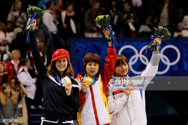 Gold medalist Wang Meng of China celebrates with silver medalist Katherine Reutter of the United States and bronze medalist Park SeungHi of South...