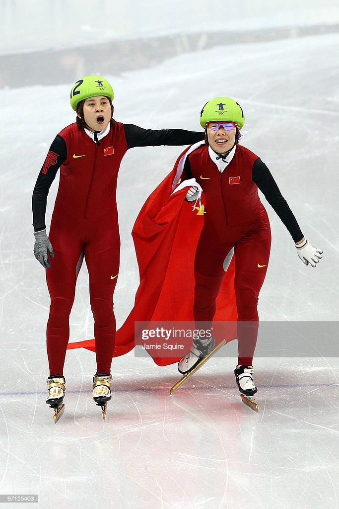 Gold medalist <a gi-track='captionPersonalityLinkClicked' href=/galleries/search?phrase=Wang+Meng&family=editorial&specificpeople=774285 ng-click='$event.stopPropagation()'>Wang Meng</a> (L) of China celebrates with <a gi-track='captionPersonalityLinkClicked' href=/galleries/search?phrase=Zhou+Yang&family=editorial&specificpeople=2199417 ng-click='$event.stopPropagation()'>Zhou Yang</a> in the Ladies 1000m Short Track Speed Skating Final on day 15 of the 2010 Vancouver Winter Olympics at Pacific Coliseum on February 26, 2010 in Vancouver, Canada.