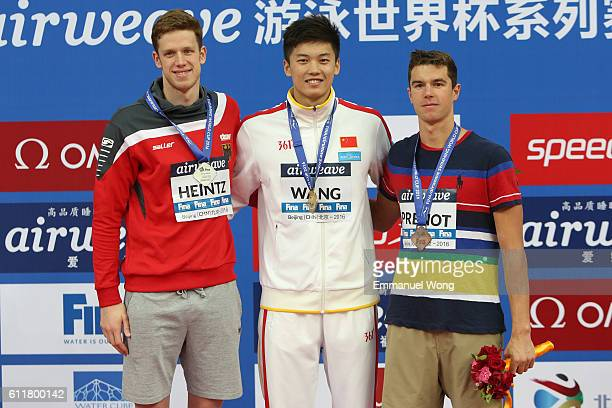 Gold medalist Wang Shun of China Silver medalist Philip Heintz of Germany and bronze medalist Josh Prenot of USA pose during the medal ceremony for...