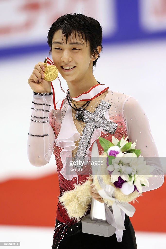 Gold medalist winner Yuzuru Hanyu poses for photographs at the medal ceremony during day two of the 81st Japan Figure Skating Championships at Makomanai Sekisui Heim Ice Arena on December 22, 2012 in Sapporo, Japan.