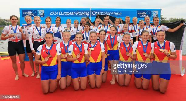 Gold medalist women's team of Romania Silver medalist women's team of Great Britain and Bronze medalist women's team of Germany pose with their...