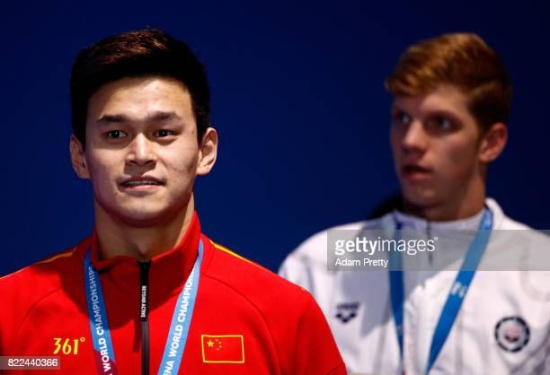 Gold medalist Yang Sun of China and Silver medalist Townley Haas of the United States pose with the medals won during the Men's 200m Freestyle final...
