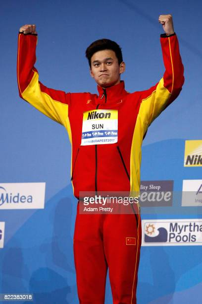 Gold medalist Yang Sun of China celebrates during the medal ceremony for the Men's 200m Freestyle final on day twelve of the Budapest 2017 FINA World...