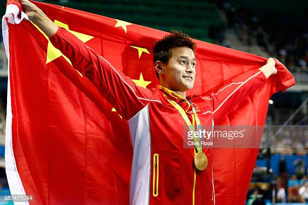 Gold medalist Yang Sun of China poses during the medal ceremony for the Men's 200m Freestyle Final on Day 3 of the Rio 2016 Olympic Games at the...
