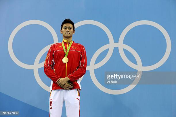 Gold medalist Yang Sun of China poses on the podium during the medal ceremony for the Men's 200m Freestyle Final on Day 3 of the Rio 2016 Olympic...