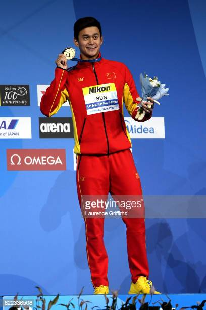 Gold medalist Yang Sun of China poses with the medal won during the Men's 200m Freestyle final on day twelve of the Budapest 2017 FINA World...