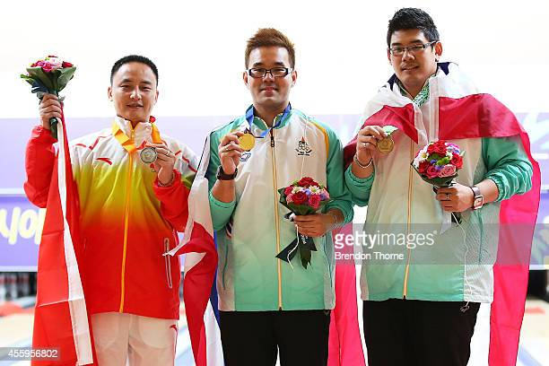Gold medalist Yannaphon Larp Apharat of Thailand Silver medalist Jianchao Du and Bronze medalist Sithiphol Kunaksorn of Thailand pose atop the podium...