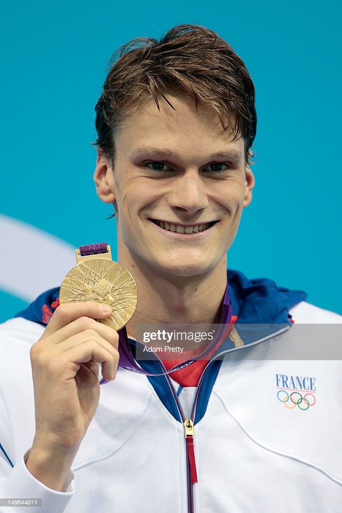 Gold medalist <a gi-track='captionPersonalityLinkClicked' href=/galleries/search?phrase=Yannick+Agnel&family=editorial&specificpeople=6567514 ng-click='$event.stopPropagation()'>Yannick Agnel</a> of France celebrates with his medal during the medal ceremony for the Men's 200m Freestyle on Day 3 of the London 2012 Olympic Games at the Aquatics Centre on July 30, 2012 in London, England.