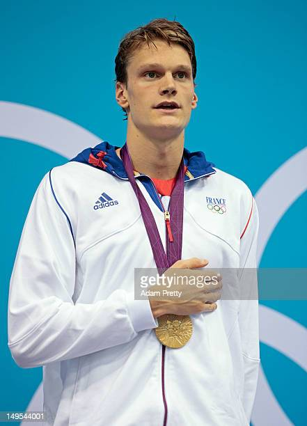 Gold medalist Yannick Agnel of France stands for the performance of the Fench National Anthem during the medal ceremony for the Men's 200m Freestyle...