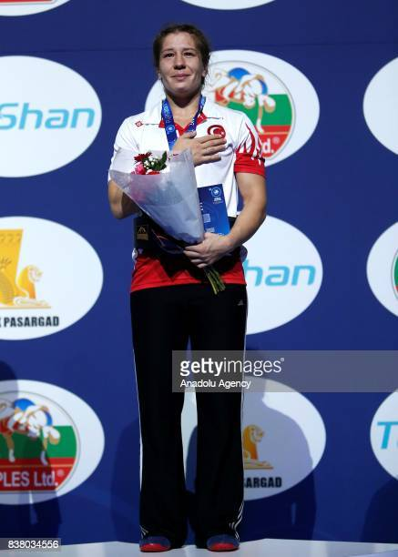 Gold Medalist Yasemin Adar of Turkey poses with her medal after the final of the Women's wrestling 75kg category during the Wrestling World...