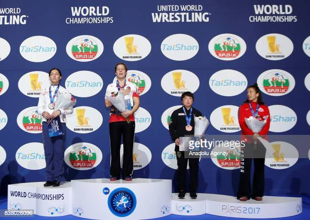 Gold Medalist Yasemin Adar of Turkey poses with her medal for the final of the Women's wrestling 75kg category during the Wrestling World...