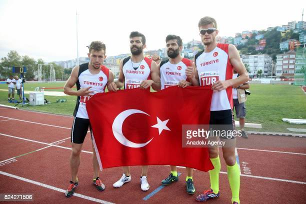 Gold medalist Yasin Suzen of Turkey and Hasan Huseyin Baydas and Sukru Cetinkaya of Turkey hold a Turkish flag after the Men's 4x400 metres relay...
