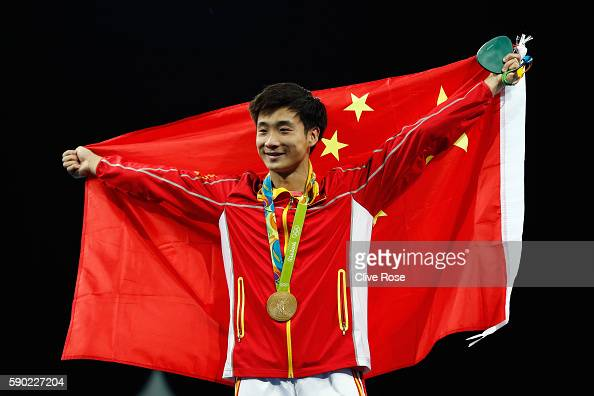 Gold medalist Yuan Cao of China poses during the medal ceremony for the Men's Diving 3m Springboard final at the Maria Lenk Aquatics Centre on August...