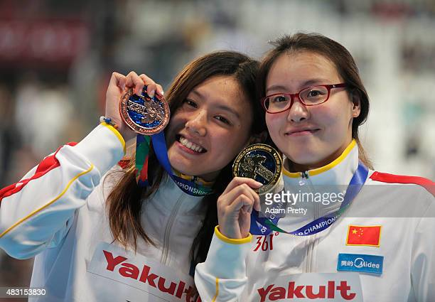 Gold medalist Yuanhui Fu of China poses with bronze medalist Xiang Liu of China during the medal ceremony for the Women's 50m Backstroke on day...