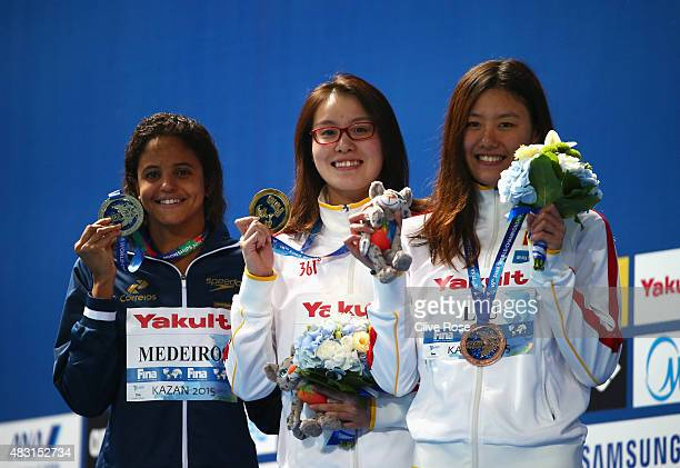 Gold medalist Yuanhui Fu of China poses with silver medalist Etiene Medeiros of Brazil and bronze medalist Xiang Liu of China during the medal...
