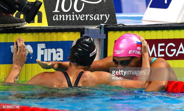 Gold medalist Yuliya Efimova of Russia is congratulated by silver medalist Bethany Galat of the United States during the Women's 200m Breaststroke...