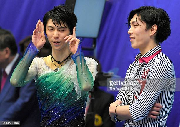 Gold medalist Yuzuru Hanyu and bronze medalist Keiji Tanaka of Japan are seen prior to the medal ceremony for the Men's Singles during day two of the...
