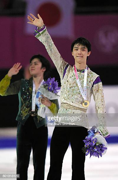 Gold medalist Yuzuru Hanyu of Japan and bronze medalist Shoma Uno of Japan applaud fans after the medal ceremony for the Men's Singles during day...