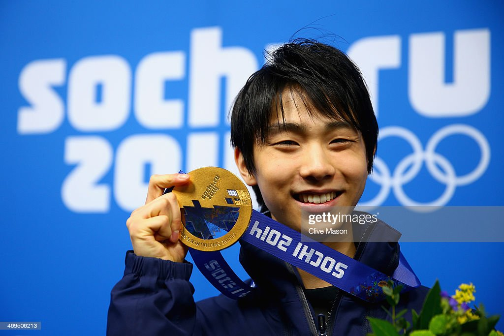 Gold medalist Yuzuru Hanyu of Japan celebrates during the medal ceremony for the Men's Figure Skating on day 8 of the Sochi 2014 Winter Olympics at Medals Plaza on February 15, 2014 in Sochi, Russia.