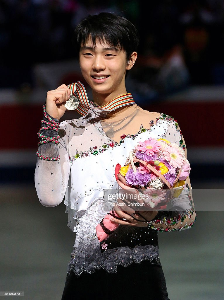 Gold medalist Yuzuru Hanyu of Japan poses for photographs at the victory ceremony for the Men's Singles Free Program during day three of the ISU World Figure Skating Championships at Saitama Super Arena on March 28, 2014 in Saitama, Japan.