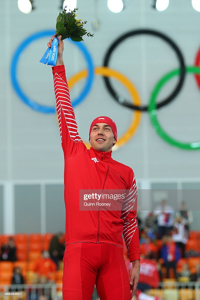 Gold medalist Zbigniew Brodka of Poland celebrates during the flower ceremony for the Men's 1500m Speed Skating event on day 8 of the Sochi 2014 Winter Olympics at Adler Arena Skating Center on February 15, 2014 in Sochi, Russia.