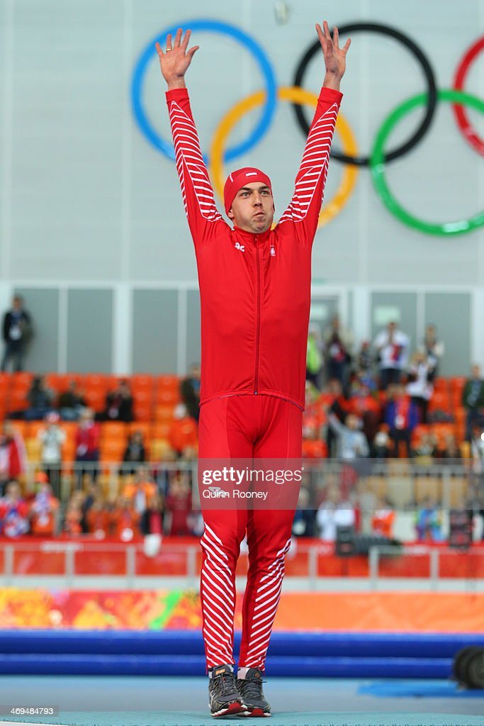 Gold medalist Zbigniew Brodka of Poland celebrates on the podium during the flower ceremony for the Men's 1500m Speed Skating event on day 8 of the Sochi 2014 Winter Olympics at Adler Arena Skating Center on February 15, 2014 in Sochi, Russia.