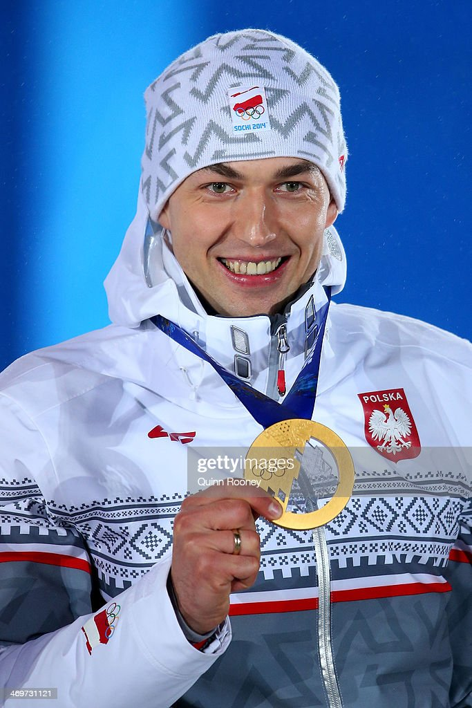 Gold medalist Zbigniew Brodka of Poland celebrates on the podium during the medal ceremony for the Men's 1500 m Speed Skating on day 9 of the Sochi 2014 Winter Olympics at Medals Plaza on February 16, 2014 in Sochi, Russia.