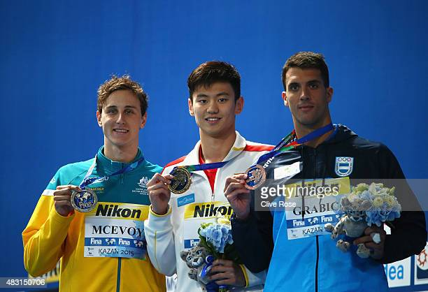 Gold medalist Zetao Ning of China poses with silver medalist Cameron McEvoy of Australia and bronze medalist Federico Grabich of Argentina during the...