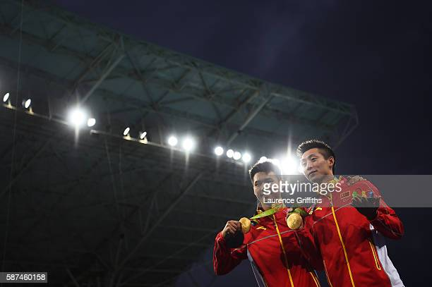 Gold medalists Aisen Chen and Yue Lin of China pose during the medal ceremony for the Men's Diving Synchronised 10m Platform Final on Day 3 of the...