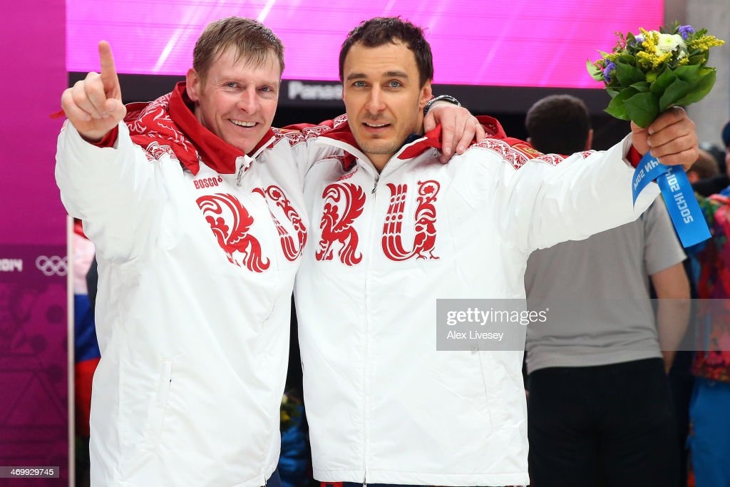 Gold medalists Alexander Zubkov and <a gi-track='captionPersonalityLinkClicked' href=/galleries/search?phrase=Alexey+Voevoda&family=editorial&specificpeople=791175 ng-click='$event.stopPropagation()'>Alexey Voevoda</a> of Russia team 1 celebrate during the flower ceremony for the Men's Two-Man Bobsleigh on Day 10 of the Sochi 2014 Winter Olympics at Sliding Center Sanki on February 17, 2014 in Sochi, Russia.