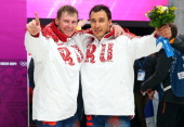 Gold medalists Alexander Zubkov and Alexey Voevoda of Russia team 1 celebrate during the flower ceremony for the Men's TwoMan Bobsleigh on Day 10 of...