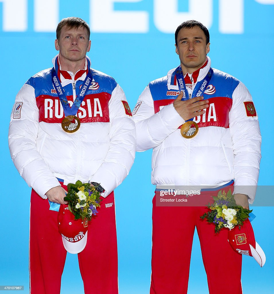 Gold medalists Alexander Zubkov (L) and <a gi-track='captionPersonalityLinkClicked' href=/galleries/search?phrase=Alexey+Voevoda&family=editorial&specificpeople=791175 ng-click='$event.stopPropagation()'>Alexey Voevoda</a> of Russia team 1 celebrate on the podium during the medal ceremony for the Men's Two-Man Bobsleigh on day 11 of the Sochi 2014 Winter Olympics at Medals Plaza on February 18, 2014 in Sochi, Russia.