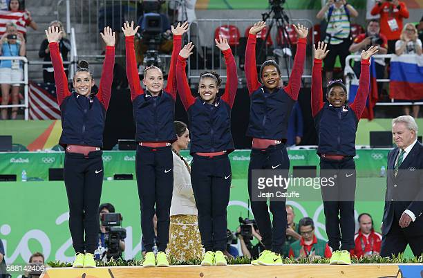 Gold medalists Alexandra Raisman Madison Kocian Lauren Hernandez Gabrielle Douglas and Simone Biles of the United States pose during the medal...
