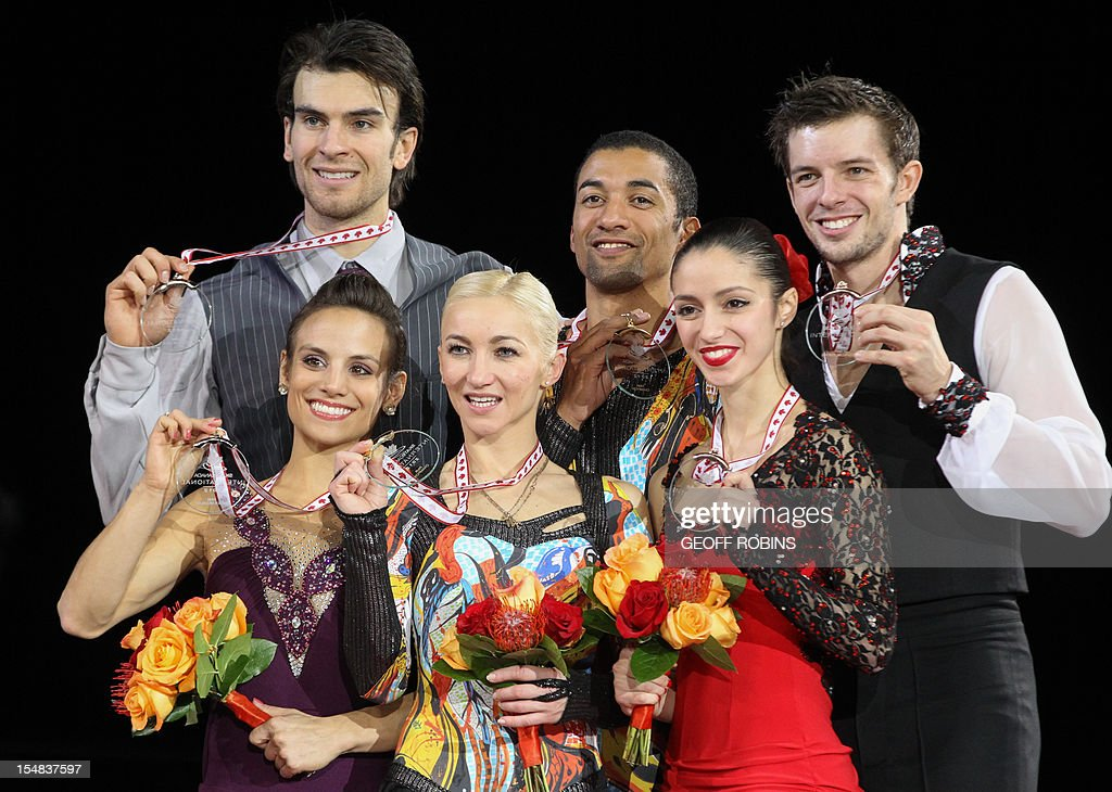 Gold medalists Aliona Savchenko and Robin Szolkowy (C) of Germany are joined by silver medalists Meagan Duhamel and Eric Radford (L) of Canada and bronze medalists Stefania Berton and Ondrej Hotarek of Italy during the pairs medals ceremony at the 2012 Skate Canada International ISU Grand Prix event in Windsor on October 27, 2012. AFP PHOTO/Geoff Robins