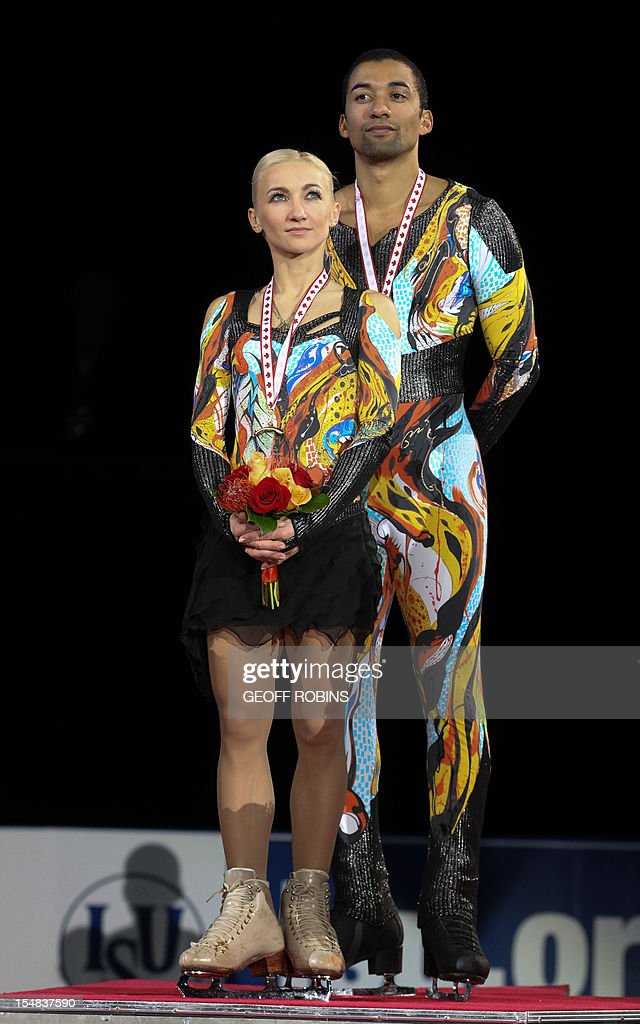 Gold medalists Aliona Savchenko and Robin Szolkowy of Germany stand on the podium during the pairs medals ceremony at the 2012 Skate Canada International ISU Grand Prix event in Windsor on October 27, 2012. AFP PHOTO/Geoff Robins