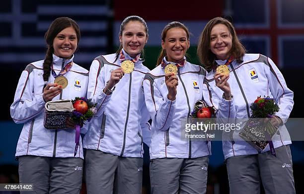Gold medalists Amalia Tataran Simona Pop Simona Gherman and Ana Maria Branza of Romania pose on the medal podium following the Women's Fencing Team...