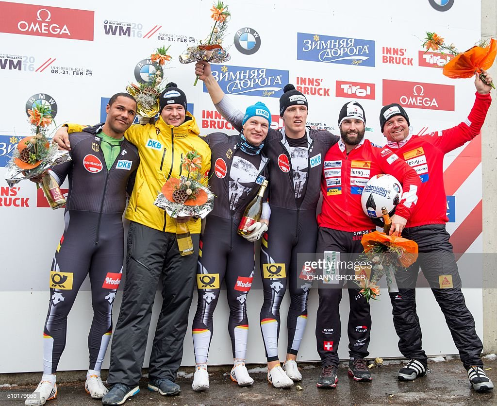 Gold medalists and World Champions Francesco Friedrich and Thorsten Margis of Germany (C), Silver medalists Johannes Lochner and Joshua Bluhm of Germany and Bronze medalists Beat Hefti and Alex Baumann of Switzerland (R) celebrate on the podium after the two-men Bobsleigh event of the Bobsleigh and Skeleton World Championships in Innsbruck/Igls, Austria, February 14, 2016. / AFP / APA / Johann Groder / Austria OUT