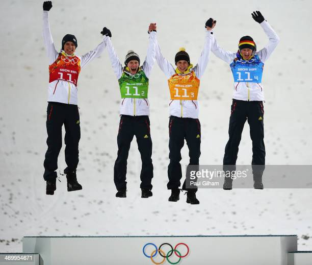 Gold medalists Andreas Wank Marinus Kraus Andreas Wellinger and Severin Freund of Germany celebrate during the flower ceremony for the Men's Team Ski...